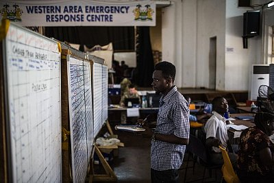 """19 Feb 2015, Freetown, Sierra Leone --- Health workers monitored Ebola cases at the District Emergency Response Center in Freetown. Despite the rate of Ebola's spread in Sierra Leone being dramatically reduced by the massive international and domestic medical response, many health officials refer to this period with the catch phrase """"the bumpy road to zero."""" As epidemics taper off, it is common to find new complications in the effort to reach zero cases — in Sierra Leone, the trade between cities and remote fishing villages is one of the remaining vectors for the spread of the virus. --- Image by © Bryan Denton/Corbis"""